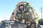 U. S. Marine Lance Cpl. Kenneth N. Dills goes through the decontamination process after carrying out the proper procedures for a chemical, biological, radiological, and nuclear attack during CBRN Assessment 120831-M-GX379-352.jpg