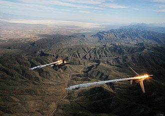 28th Bomb Squadron - A two-ship formation of U.S. Air Force B-1B Lancers assigned to the 28th Bomb Squadron, Dyess Air Force Base, Texas, releases chaff and flares while maneuvering over New Mexico during a training mission 24 Feb 2010.