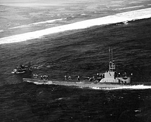 USS Harder (SS-257) - Harder rescuing VF-8 pilot Ens. John R. Galvin off Woleai, 1 April 1944.