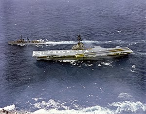 "Mercury-Atlas 9 - The crew of USS Kearsarge spells out ""MERCURY 9"" on the flight deck while underway to the recovery area"