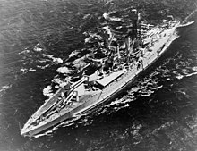A large warship in the water, seen from above