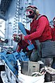 US Navy 020910-N-6817C-002 inspecting practice bombs aboard USS Lincoln.jpg