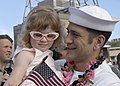 US Navy 030424-N-5376G-047 A sailor greets his daughter after debarking from the Los Angeles class attack submarine USS Cheyenne (SSN 773) upon returning from deployment in support of Operation Iraqi Freedom.jpg