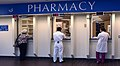 US Navy 030819-N-9593R-050 Patients and staff wait for medications at the pharmacy windows at the National Naval Medical Center in Bethesda, Maryland.jpg