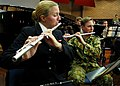 US Navy 030908-N-7712H-007 Musician 3rd Class Alaina Ilko, left, assigned to the U.S. Pacific Fleet Band, and Royal Australian Army Band Musician Paul Broomhead play their flutes.jpg