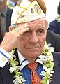 US Navy 031207-N-7391W-070 Authur Forcier, Hawaii's state Commander of the Disabled American Veterans, salutes the national ensign during the 62nd anniversary of the attack on Pearl Harbor.jpg
