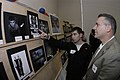 US Navy 041027-N-6477M-072 Photographer's Mate Airman Jacob Kirshows his portfolio to his father during the Walter L. Richardson Photographer of the Year awards held on board Naval Station Everett, Wash.jpg