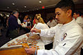 US Navy 050409-N-9693M-436 White House Chef Culinary Specialist 1st Class Ernesto Alvarez serves Navy Bean soup to visitors at the Navy Memorial.jpg