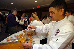 Navy bean - Image: US Navy 050409 N 9693M 436 White House Chef Culinary Specialist 1st Class Ernesto Alvarez serves Navy Bean soup to visitors at the Navy Memorial