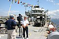 US Navy 050617-N-8110K-085 A member of the local media interviews LST Memorial Crew Captain Robert Jornlin on deck of LST 325.jpg