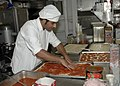 US Navy 050629-N-6616W-003 An Italian cook assigned to the Italian Ship ITS Granatiere (F585), make pizza aboard the amphibious transport ship USS Nashville (LPD 13).jpg