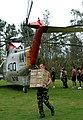 US Navy 050901-N-8047K-129 U.S. Navy Sailors and civilian personnel unload food and water from a UH-3H Sea King helicopter, transported from Naval Air Station Pensacola, Fla., to provide support and relief to victims of Hurrica.jpg