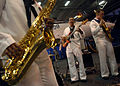 US Navy 060523-N-9742R-463 Members of the U.S. Navy 6th Fleet Band play at a reception held in the ship's hangar bay aboard the nuclear-powered aircraft carrier USS Enterprise (CVN 65).jpg