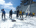 US Navy 060820-N-3455P-004 Sailors conduct a scrubbing exercise on the flight deck aboard the amphibious assault ship USS Boxer (LHD 4) as after testing the ship's Aqueous Film Forming Foam (AFFF) stations.jpg