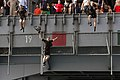 US Navy 070522-N-0890S-037 Search and Rescue (SAR) swimmers jump from elevator 3 during swim call aboard the nuclear-powered aircraft carrier USS Nimitz (CVN 68).jpg