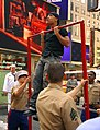 US Navy 070523-N-2984R-108 Military personnel assigned to U.S. Armed Forces Career Center on Times Square New York, watch as a New Yorker does pull-ups during an event where people from the city signed up to show off their phys.jpg