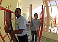 US Navy 070721-N-6669H-004 Religious Programs Specialist 2nd Class Fredrick Jones and Quartermaster Seaman Manuel Gomez help move scaffolding during an engineering civic action program at the Hoa Phouc Clinic in support of Paci.jpg