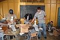 US Navy 070919-N-9486C-019 Sailors assigned to High Speed Vessel (HSV 2) Swift assemble ceiling fans during a community relations projects at Thichfield School.jpg