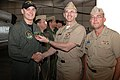 US Navy 080117-N-0311M-001 Adm. Jonathan W. Greenert presents the Navy Achievement Medal to Aviation Warfare Systems Operator 2nd Class Derik Blackman. Blackman was part of a Search and Rescue mission to locate and recover a d.jpg