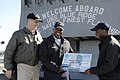 US Navy 080215-N-8546L-037 Capt. David A. Lausman, commanding officer of the amphibious command ship USS Blue Ridge (LCC 19), presents a check for $25,000 toward the ship's Morale, Welfare and Recreation (MWR) program.jpg