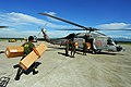 US Navy 080701-N-0640K-046 Soldiers with the Armed Forces of the Philippines carry relief supplies to a waiting SH-60F Seahawk assigned to Helicopter Anti-Submarine Squadron (HS) 4 for delivery to remote locations on the island.jpg