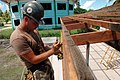 US Navy 080823-N-1328S-002 Constructionman Steven Cline, assigned to Navy Mobile Construction Battalion (NMCB) 133, makes adjustments for the reconstruction of Mwan Elementary School during a Pacific Partnership engineering civ.jpg