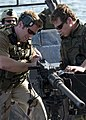 US Navy 080903-N-4500G-277 Special Warfare Combatant-craft Crewmen clear a jammed .50-caliber machine gun.jpg