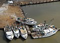 US Navy 080919-N-6575H-643 Damaged boats are seen in this aerial photograph at a boatyard on the Bolivar Peninsula in Galveston, Texas. Hurricane Ike struck the Texas Gulf Coast.jpg