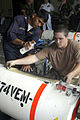 US Navy 090709-N-7783B-068 Royal Thai Navy Petty Officer 1st Class Prasith Cunchinda and Mineman 3rd Class Devin Keeton, assigned to Mobile Mine Assembly Unit 10, label training mines in preparation for Cooperation Afloat Readi.jpg
