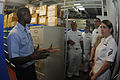 US Navy 090731-N-7478G-020 Storekeeper 1st Class Yayah Sesay, assigned to the amphibious command ship USS Blue Ridge (LCC 19), gives a tour of the stock control office.jpg