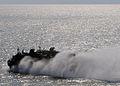 US Navy 100306-N-1082Z-018 A landing craft air cushion, assigned to Assault Craft Unit (ACU) 4, departs the amphibious dock landing ship USS Ashland (LSD 48).jpg