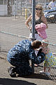 US Navy 100601-N-6674H-002 A Sailor kisses his daughter goodbye before leaving on western Pacific deployment.jpg