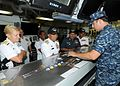 US Navy 100802-N-6632S-123 Rear Adm. Nora Tyson and Adm. Tan Sri Abdul Aziz Jaafar receive a brief in flight deck control during a tour aboard USS George H.W. Bush (CVN 77).jpg