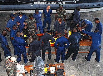 Barbados Defence Force - Image: US Navy 100817 N 4971L 021 Members of the Royal Barbados Defense Force disassemble a small boat engine during a maintenance management subject matter expert exchange