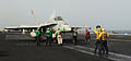 US Navy 100830-N-6362C-073 Sailors guide an F-A-18C Hornet to the catapults for launch aboard USS Harry S. Truman (CVN 75).jpg