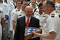 US Navy 101013-N-6736S-055 Georgia Gov. Sonny Perdue, left, is presented a flag that was flown over the Ohio-class guided-missile submarine USS Geo.jpg