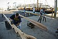 US Navy 110122-N-6674H-001 Sailors sand down pieces of a Polynesian canoe for the Polynesian Voyaging Society.jpg