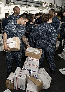 US Navy 111220-N-VO377-231 Sailors assigned to the Nimitz-class aircraft carrier USS Abraham Lincoln (CVN 72) sort through 36 pallets of mail durin.jpg
