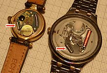 photograph of the workings of 2 quartz watches