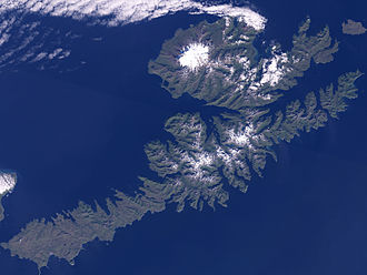 Makushin Volcano - NASA satellite view of Unalaska Island. Makushin is the prominent white snowy area to the northwest