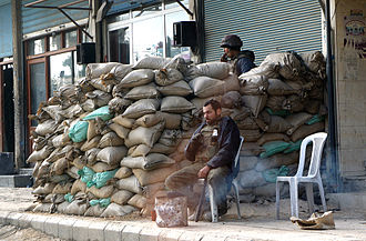 Timeline of the Syrian Civil War - Syrian army checkpoint in Douma, January 2012