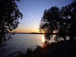 Vapour trail over St. Clair lake.jpg