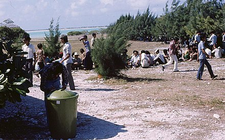 Vietnamese refugees on Wake Island await resettlement processing by U.S. Immigration and Naturalization Service personnel in May 1975 Vietnamese refugees on Wake Island.jpg