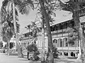 View of building, a canon and many palm trees (AM 78449-1).jpg