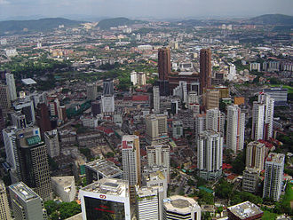Geography of Kuala Lumpur - Bukit Bintang in the foreground with the Titiwangsa Mountains in the background.