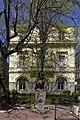 Vue 2 de la façade sud de l'ancienne chambre de commerce et d'industrie de saint etienne et homme à la panthère.jpg