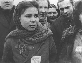 "Unfree labour - Female forced laborers wearing ""OST"" (Ost-Arbeiter) badges are liberated from a camp near Lodz, January 1945."