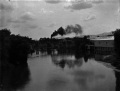 "Waihou River at Te Aroha, showing ""N"" class steam locomotive with the Auckland to Thames Express on the railway bridge. ATLIB 293241.png"