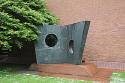 Bronze sculpture outside brick building
