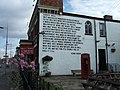 Wall poem and pub tables, Wilmslow Road, Manchester - geograph.org.uk - 1393195.jpg